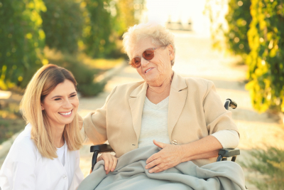 senior woman in wheelchair and nurse