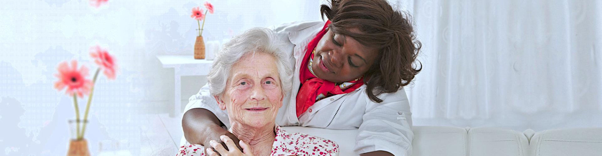 caregiver having a coversation to senior woman