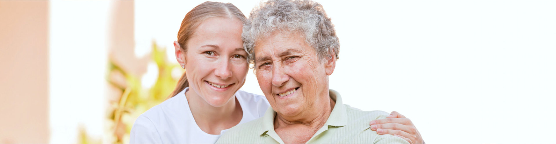 caregiver woman and senior woman are smiling